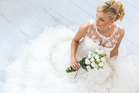 a bride in dry cleaned wedding dress